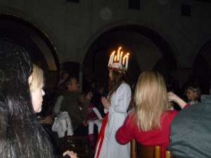 As is tradition all over teh world, a girl is chosen to play Santa Lucia and wear her crown of candles.
