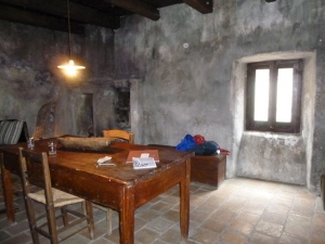 A rustic interior, furnished as it might have been hundreds of years ago.