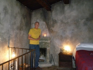 Ric in our rustic bedroom. A terrific night's sleep awaited us.