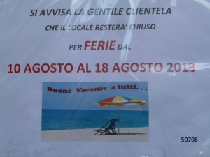 A more formal sign assures  customers of this cafe that they will only be closed a week.  Everyone to the beach!