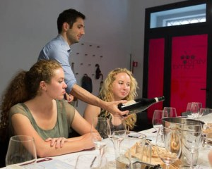 Maurizio shares wine and knowledge with two young Americans. Photo by Michael Horne.
