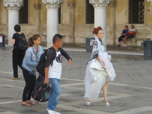 Bride readying for pictures in Piazza San Marco