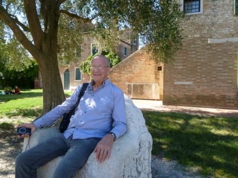 Ric relaxes on a stone throne, Torcello
