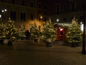 In a piazza, a forest of Christmas trees surrounds a little cabin where Babbo Natale hears the wishes of the bambini.