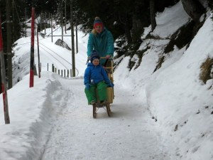 "On the trail, a mother pushes her children in a ""sledge"""