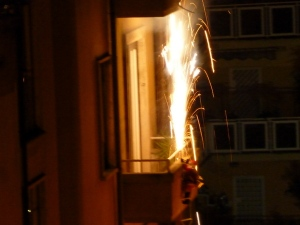 Kids, don't try this at home. Our neighbor across the street shot off Roman Candles from his oh-so-tiny balcony on NYE. Note the Santa figure climbing a ladder hanging from the balcony. And this goes on all over the city!