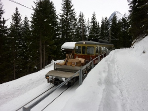 The train to Murren parallels the trail for much of the way. Note the open air baggage car for luggage, supplies, skies.
