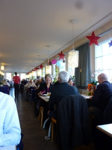 The dining room at Restaurant Bahnhoff Buffet, full of locals, no English.
