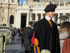 A handsome Swiss Guard redirects those who were clearly not meant to be a part of the Papal celebration.