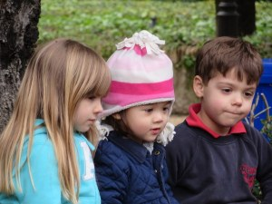 These kids are a little young to be so entranced by a mere president. The object of their attention: a movie on aniPad.