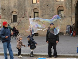 Street performers are everywhere in Italy. Bologna is the first place we have seen bubble blowers. Kids had a great time running after them.