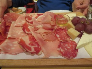 "A typical Bolognese ""tagliere"" or cutting board of assorted salumi.  Mortadella on the left."