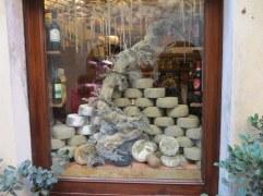 Artful display on pecorino in a Pienza window. Brought home a few kilos....
