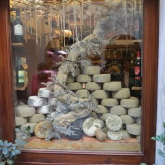 Artful display on pecorino in a Pienza window. Brought home a few kilos....