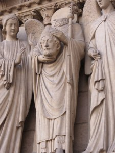 Saint Dennis holding his head, facade of Notre Dame.