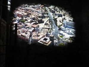 A movie is projected on the ruins showing the creation of Via Fori Imperiali.