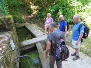Stefano, foreground, explains a fountain in the mountains to Jane, Rick and Ric. Multiple basins allowed people to use one for drnking water, the next for washing, and a final one for watering livestock.