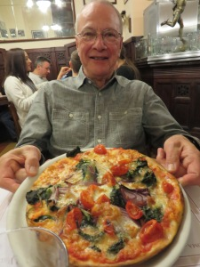 Now that's a pizza! Ric Barton displays a work-of-art in Roma.