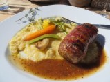 My choice: a baby meatloaf wrapped in pancetta served with molten-hot cheesy polenta and vegetables.