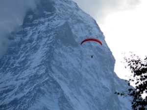 Sunset paraglider in front of the Matterhorn.