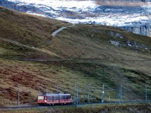 A Jungfraujoch train moves up the mountain. Most of the journey is in a tunnel inside the Eiger and the Mönch.
