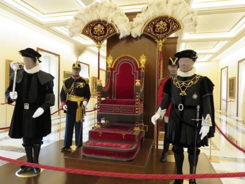 Papal throne and entourage.