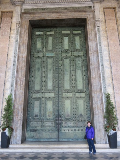 Big big doors, appropriated from the Senate House. The purple smudge is me.