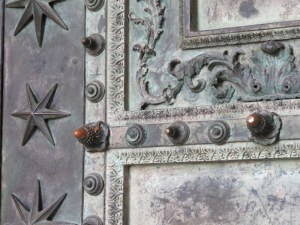 "Close up of the doors, originally from the Curia. The acorn ""studs"" date to the 3rd century."