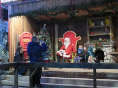 Babbo Natale receives kids in a very low-key style in Milano Christmas Village. Note the parents taking their own photos!