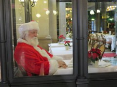 Babbo Natale takes his break at a cafe, Galleria Vittorio Emanuele.