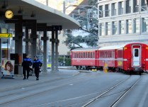 The train runs right down the middle of the street in Chur.
