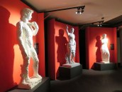Three Italian statues: The David, Caesar Augustus, and the Venus di Milo.