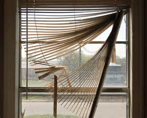 OK, nothing this bad,m to date, but we've had our share of drapes sagging on wire and shades that won't stay up...others won't stay down.