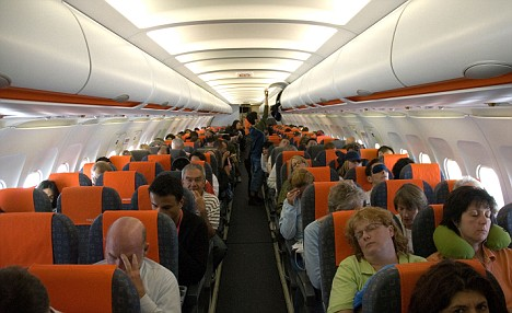 Interior of Easy Jet airplane with passengers. Courtesy of EasyJet. Yeah, this is fun.