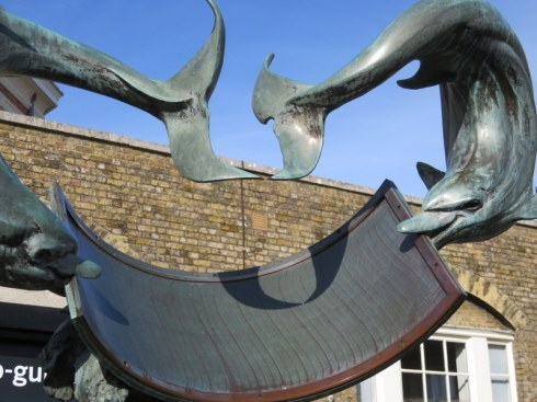 Royal Observatory, Greenwich. This is a sundial and the dolphin tails point to the hour.