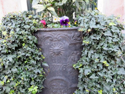 "Planter in front of Brook's Gentlemen's Club, St. James. Our guide said the ""1776"" embossed on the planters (there are two) reflects the Whigs supporting the American Revolution. The club of the Tory opposition is immediately across the street."