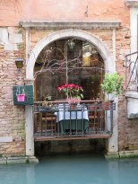 Table on a canal. What a romantic dinner spot!