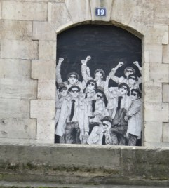 This caused a second glance. Along the Seine, painted on a portal in the floodwall, as seen from our boat tour.