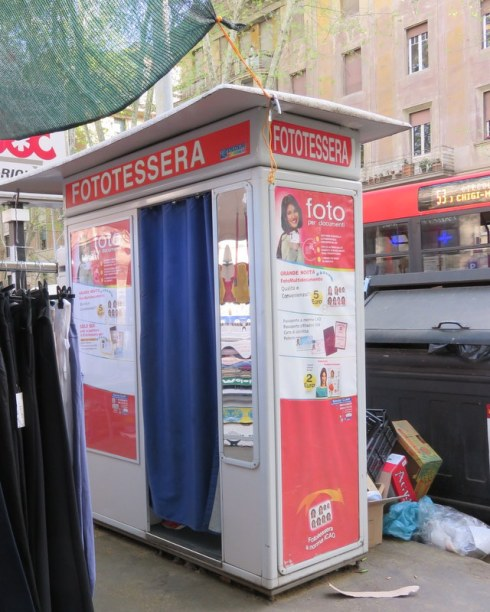 The fototessera booth, where we go for ID pictures, and where shoppers can slip in to try on clothes. Note the handy location next to overflowing trash bins.