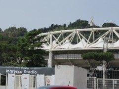 The stadium from street level. Note you can see the golden Madonna in the upper right.