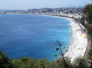 The lovely curve of the beach at Nice.