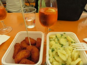 Elevensies! A spritz con Aperol with bocconcini di pollo and insalata di patate (chicken nuggets and potatoe salad). We hiked after....