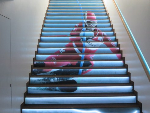 On the way out, the lighted stairway is enhanced with a skiing graphic.