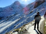 The sun defines the undulating trail from Männlichen to Kleine Scheidegg.