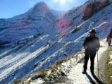The sun defines the undulating trail from Männlichen to Kleine Scheidegg.