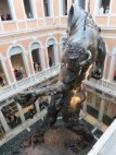 "Hirst's ""Demon with Bowl"" stands 18 meters (59 feet) tall, taking up the entire 3 -story atrium of Palazzo Grassi."