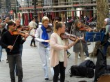 Came across a 12-person group of classical musicians on a piazza, busking on a Sunday.