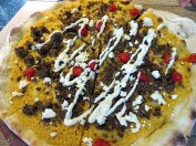 "Flatbread ""pizza"" with harissa hummus, chili spicied lamb, roquito peppers, and feta. Yum!"