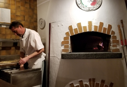Pizza oven and man