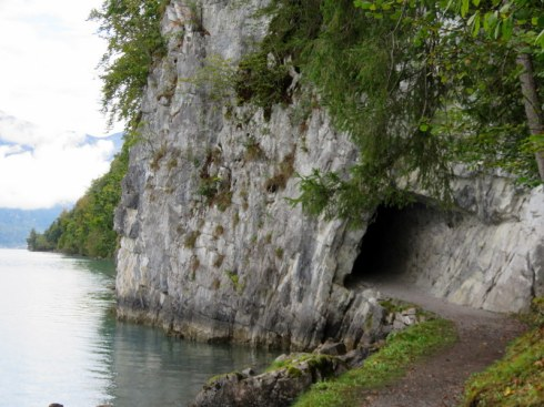 Tunnel through rock by lake